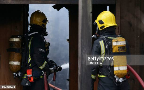 London Fire Brigade firefighters control a fire that broke out at a cafe and shop at London Zoo in London on December 23 2017 A fire broke out at...