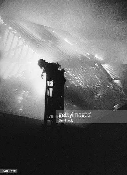 A London firefighter tackles a blaze during the Blitz 1st February 1941 Original publication Picture Post 587 Firefighters pub 1941