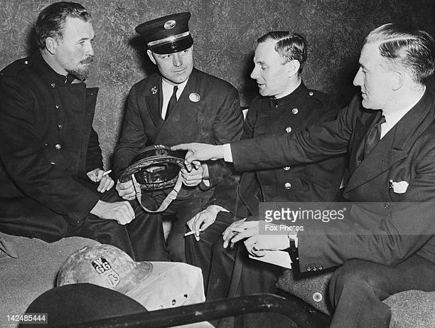 London firemen of the Auxiliary Fire Service on a visit to a New York fire station, 19th August 1941. The AFS was a British wartime civil defence...
