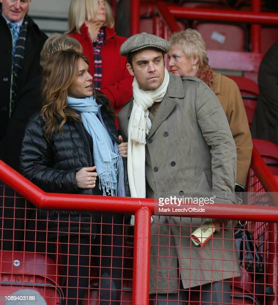 London Football League 2 Brentford v Port Vale Singer Robbie Williams watching the match with girlfriend actress Ayda Field