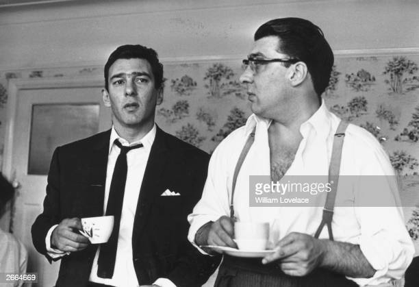 London gangsters Ronnie and Reggie Kray at home having a cup of tea They had just spent 36 hours being questioned by the police about the murder of...