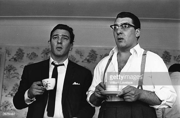 London gangsters Ronnie and Reggie Kray refresh themselves with a cup of tea They had just spent 36 hours being questioned by the police about the...