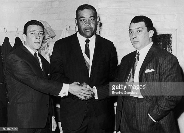 London gangsters the Kray twins Reggie and Ronnie with American heavyweight boxer Joe Louis circa 1960