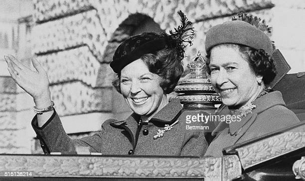 H M Queen Beatrix of the Netherlands waves to the crowd as she rides in an open carriage with H M Queen Elizabeth II past Horse Guards arch 11/16 en...