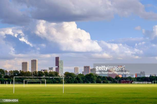 uk, london, hackney, the skyline of stratford under puffy clouds with sports playing fields, summer 2020 - east london stock pictures, royalty-free photos & images