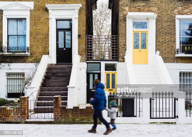 london houses on a snowy day - stock photo - winter stock pictures, royalty-free photos & images