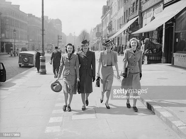 Everyday Life In London England Four young ladies enjoy a stroll in the Spring sunshine along a shopping street in the West End of London Two are...