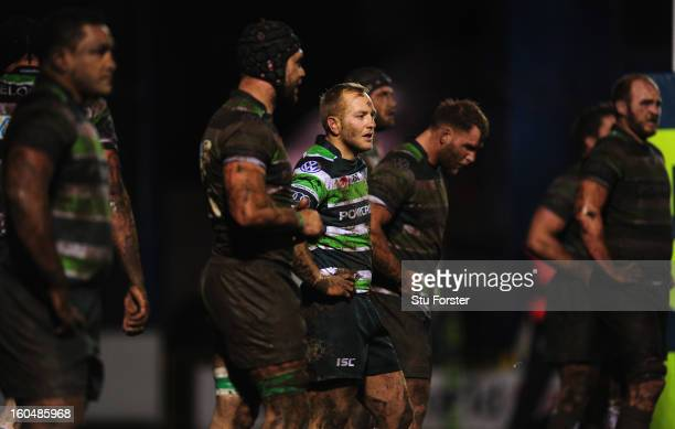 London Irish player Shane Geraghty stays clean amongst the Irish forwards covered in mud during the LV= Cup match between Cardiff Blues and London...