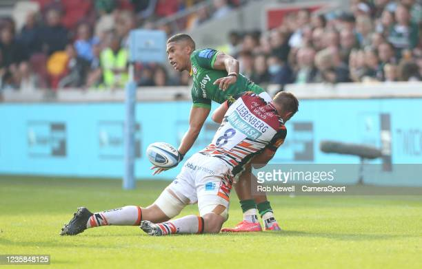 London Irish's Ben Loader is tackled by Leicester Tigers's Hanro Liebenberg during the Gallagher Premiership Rugby match between London Irish and...