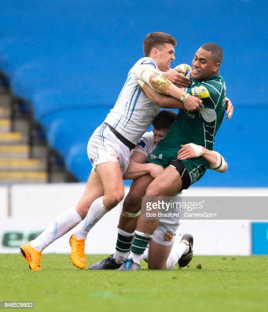 London Irish's Joe Cokanasiga is tackled by Exeter Chiefs' Henry Slade during the Aviva Premiership match between London Irish and Exeter Chiefs at...