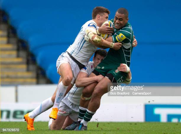 London Irish's Joe Cokanasiga is tackled by Exeter Chiefs' Henry Slade and Ian Whitten during the Aviva Premiership match between London Irish and...