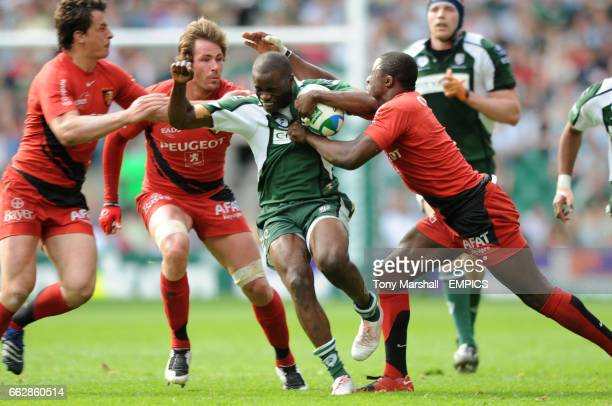 London Irish's Topsy Ojo cna't find a way past Toulouse's Yannick Nyanga and Shaun Sowerby