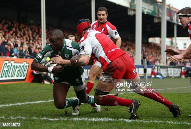 London Irish's Topsy Ojo dives over to score during the Guinness Premiership match at the Kingsholm Stadium Gloucester