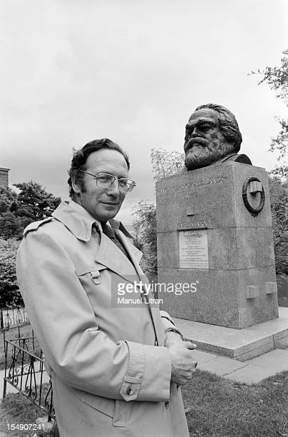 London June 11 the tomb of Karl Marx at Highgate Cemetery historian Jean ELLENSTEIN specialist communism poses in front of the statue of the...