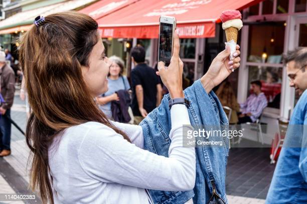 London Kensington Vendi woman taking photo of ice cream with smartphone