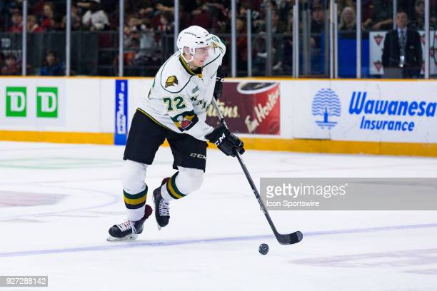 London Knights Defenceman Alec Regula skates the puck into the attacking zone during Ontario Hockey League action between the London Knights and...