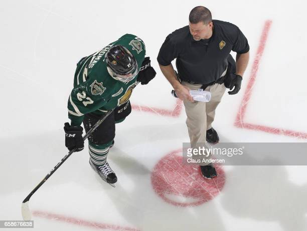 London Knights trainer Doug Stacey helps Robert Thomas off the ice against the Windsor Spitfires during Game Two of the OHL Western Conference...