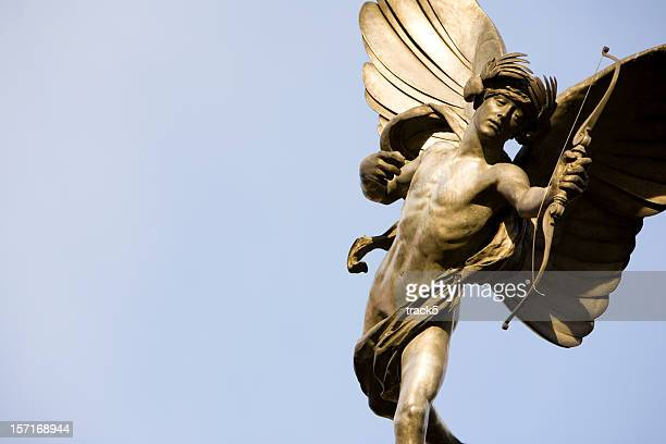 london landmark: statue of eros, piccadilly circus - male angel stock photos and pictures