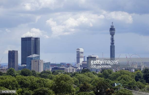 London landmarks including the BT Tower and the London Eye are pictured on the skyline in London on June 25 after the announcement that the UK had...