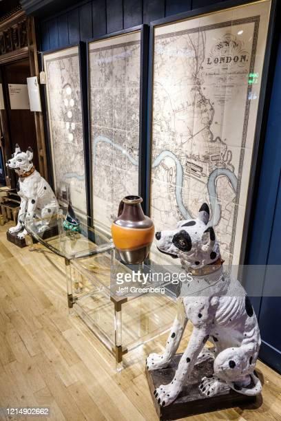 London, Liberty Department Store, large ceramic dog statues display.