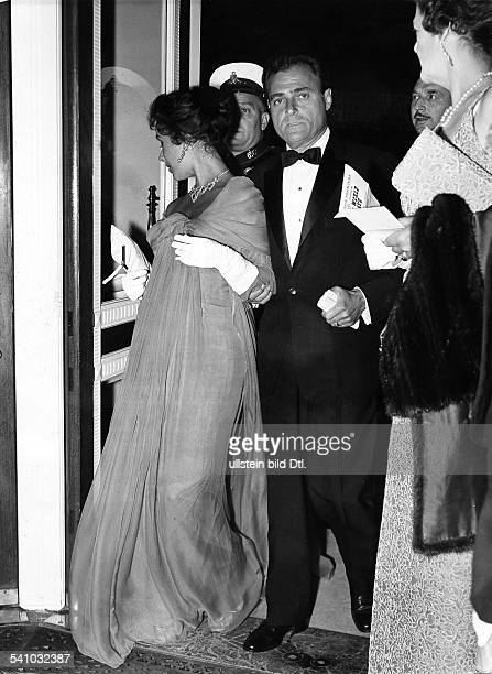GB London Liz Taylor and her husband Michael Todd visiting the premiere of the movie 'Around the world in 80 days' at the Astoria cinema She wears a...