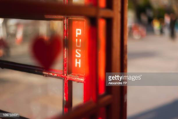 London, Love sign on telephone box