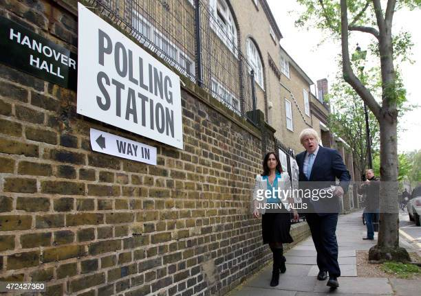 London Mayor Boris Johnson and his wife Marina Wheeler arrive to cast their vote on May 7 2015 in London as Britain holds a general election Polls...