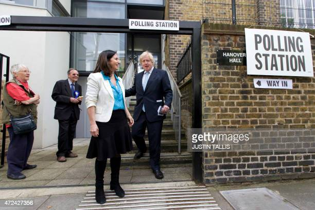 London Mayor Boris Johnson and his wife Marina Wheeler pose for photographers after casting their vote on May 7 2015 in London as Britain holds a...