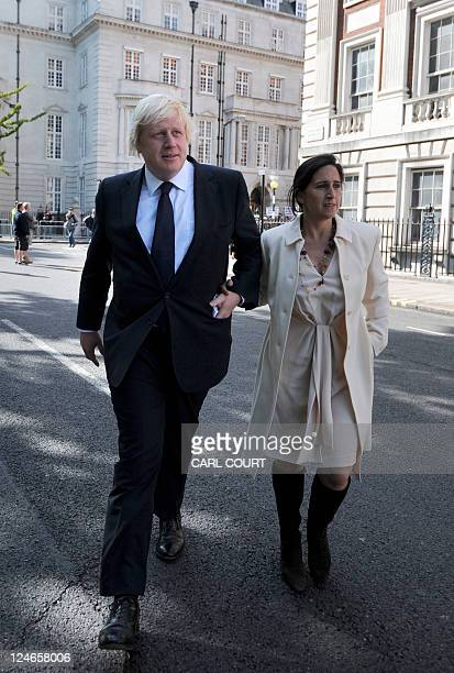 London Mayor Boris Johnson and his wife Marina Wheeler walk through Grosvenor Square on September 11 2011 to attend a ceremony to mark the 10th...