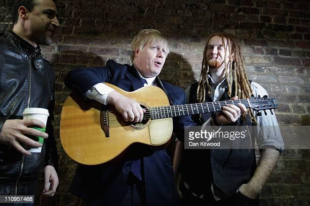 London Mayor Boris Johnson and musician Newton Faulkner attend a photocall at London Bridge Underground station on March 28 2011 in London England...