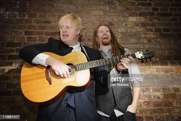 London Mayor Boris Johnson and musician Newton Faulkner pose during a photocall at London Bridge Underground station on March 28 2011 in London...