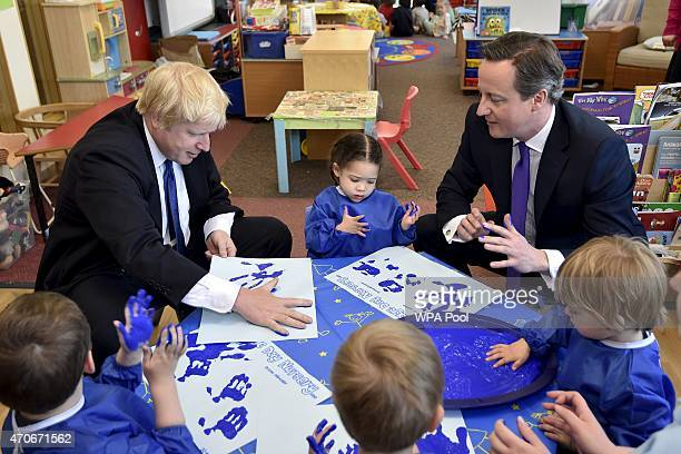 London Mayor Boris Johnson and Prime Minister David Cameron join a handprinting session with children at the Advantage children's daycare nursery on...