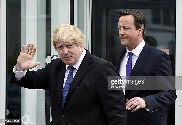 London Mayor Boris Johnson and Prime Minister David Cameron leave the Advantage children's daycare nursery on April 22 2015 in Surbiton England...