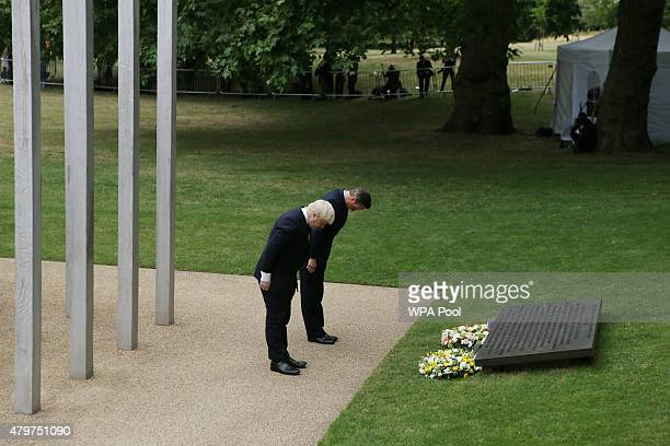London Mayor Boris Johnson British Prime Minister David Cameron place wreathes at the July 7 memorial in Hyde Park on July 7 2015 in London England...