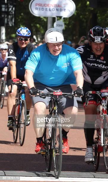 London Mayor Boris Johnson completes the Surrey 100 mile bike ride during day two of the Ridelondon Grand Prix London
