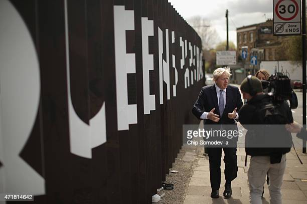 London Mayor Boris Johnson is interviewed by the BBC's Newsnight Chief Correspondent Laura Kuenssberg in between campaing stops with Conservative...