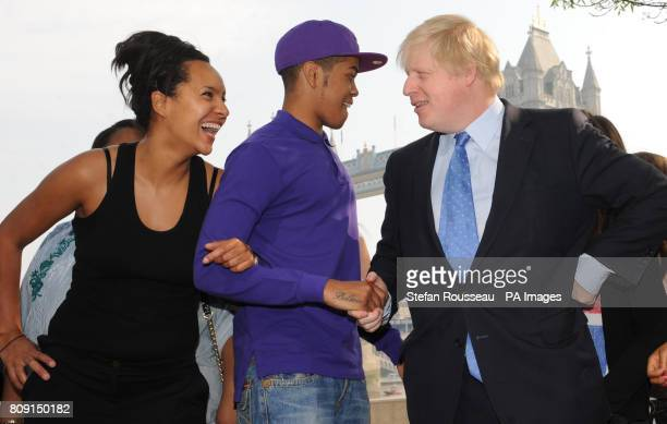 London Mayor Boris Johnson meets award winning rapper Chipmunk and Natalie Wade Director of Little Green Shoots at City Hall in London where the...