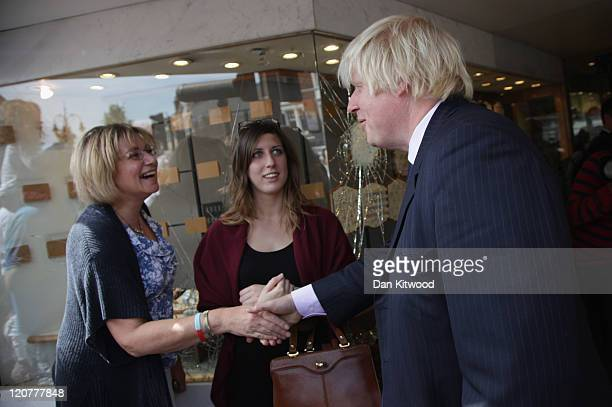 London Mayor Boris Johnson meets local residents in Enfield after the area was affected by the recent riots on August 10 2011 in London England After...