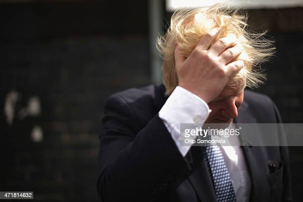 London Mayor Boris Johnson pauses while being interviewed by the BBC's Newsnight Chief Correspondent Laura Kuenssberg in between campaing stops with...