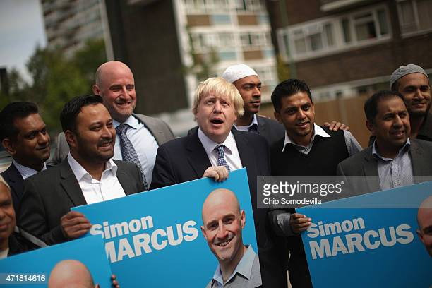 London Mayor Boris Johnson poes for photographs after meeting with imams and community leaders at the UK Albanian Muslim Community Centre in QueenÕs...