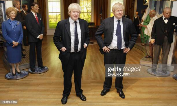 London Mayor Boris Johnson poses with a wax figure of himself as it is unveiled at the Madame Tussauds waxwork museum in London, on May 5, 2009. AFP...