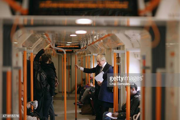 London Mayor Boris Johnson rides an Overground train in between campaingn stops with Conservative candidates on May 1 2015 in London United Kingdom...