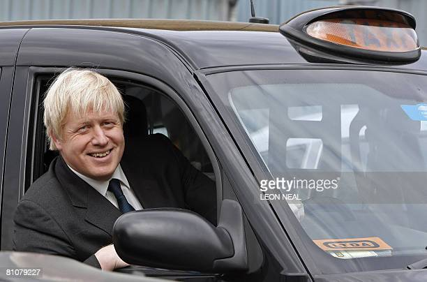 London Mayor Boris Johnson sits in a black cab at the London Taxi Driver Association in Westbourne Park London on May 14 2008 Newly elected...