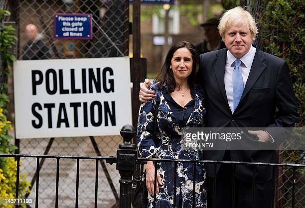 London Mayor Boris Johnson stands with his wife Marina Wheeler after casting his vote in the local elections at a polling station in north London on...