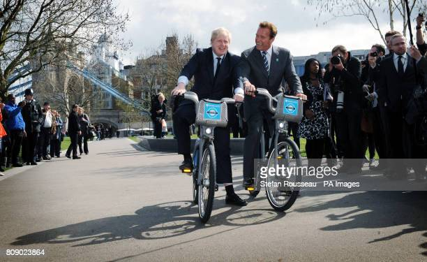 London Mayor Boris Johnson takes former Governor of California Arnold Schwarzenegger for a ride on one of his 'Boris bikes' during his visit to City...