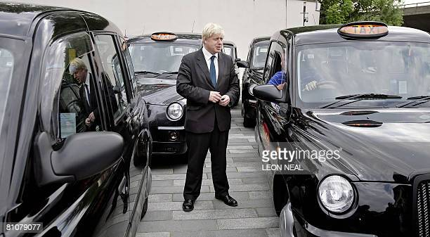 London Mayor Boris Johnson talks to a black cab driver at the London Taxi Driver Association in Westbourne Park London on May 14 2008 Newly elected...