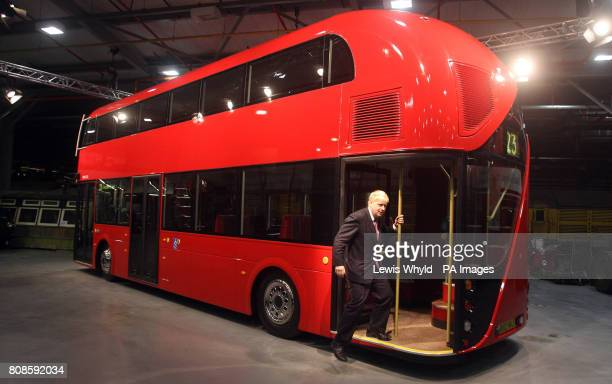 London Mayor Boris Johnson unveils a lifesize mockup of the new hopon hopoff doubledecker bus for London based on the driverandconductor Routemaster...