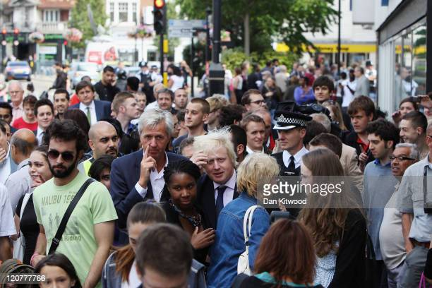 London Mayor Boris Johnson walks through Enfield greeting local residents after the area was affected by the recent riots on August 10 2011 in London...