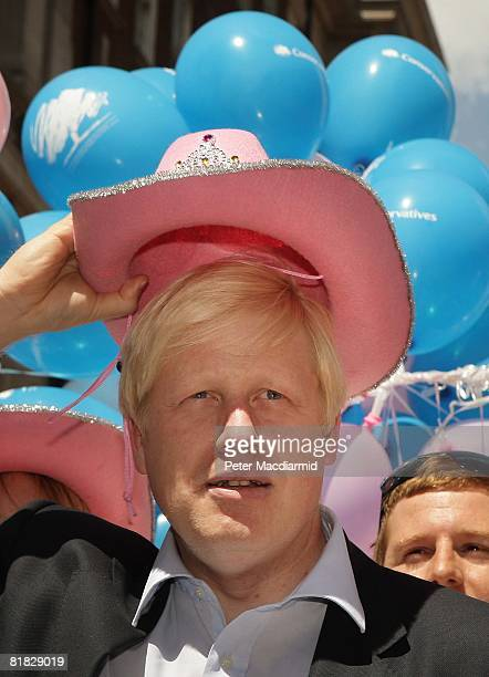 London Mayor Boris Johnson wears a pink stetson hat at the Gay Pride parade on July 5, 2008 in London, England. The parade consists of celebrities,...
