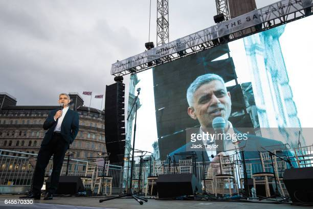 London Mayor Sadiq Khan addresses the crowd as thousands gather to watch a free screening and UK premier of Iranian film The Salesman in Trafalgar...